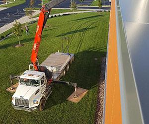 Miller Builders Supply Truck working on hotel